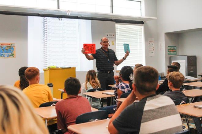 Koogler Middle School social studies teacher Gary Zuniga talks with his students, Monday, Aug. 13, 2018 in Aztec.