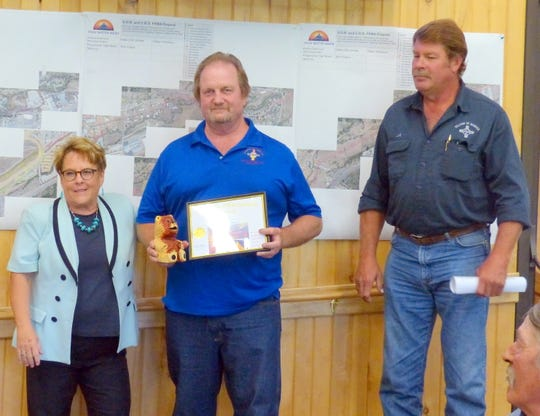 Randy Koehn was named Public Works Employee of the Quarter after kudos from Village Manager Debi Lee and Public Works Director J. R. Baumann, right.
