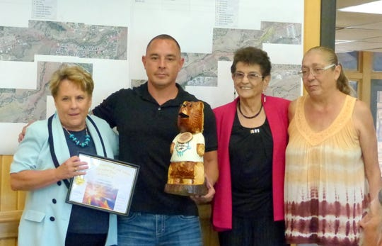 Anthony Montes, manager of the Ruidoso Community Center, and staff members Alicia Lopez and Debbie Nevarez received the Department of the Quarter Award. Village Manager Debi Lee is at left