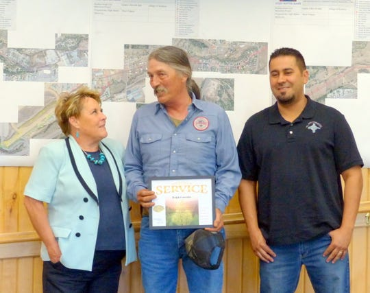 Ralph Gonzales, center, received a 30-year of service award. Wastewater plant manager Isaac Garcia stands at right.