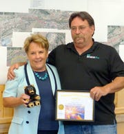 David Tetreault accepts his award for Community Services Employee of the Quarter from Village Manager Debi Lee.