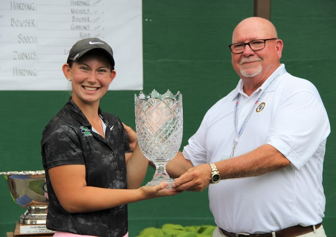 Flushing's Kerrigan Parks is the new Michigan Women's Amateur champion. Presenting the trophy at Redford's Western Golf & CC was tournament chairman and Livonia native Dan Longeway.