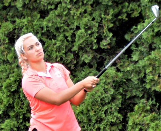 Dearborn's Elayna Bowser hits an iron in the finals of match play of the Michigan Women's Amateur.