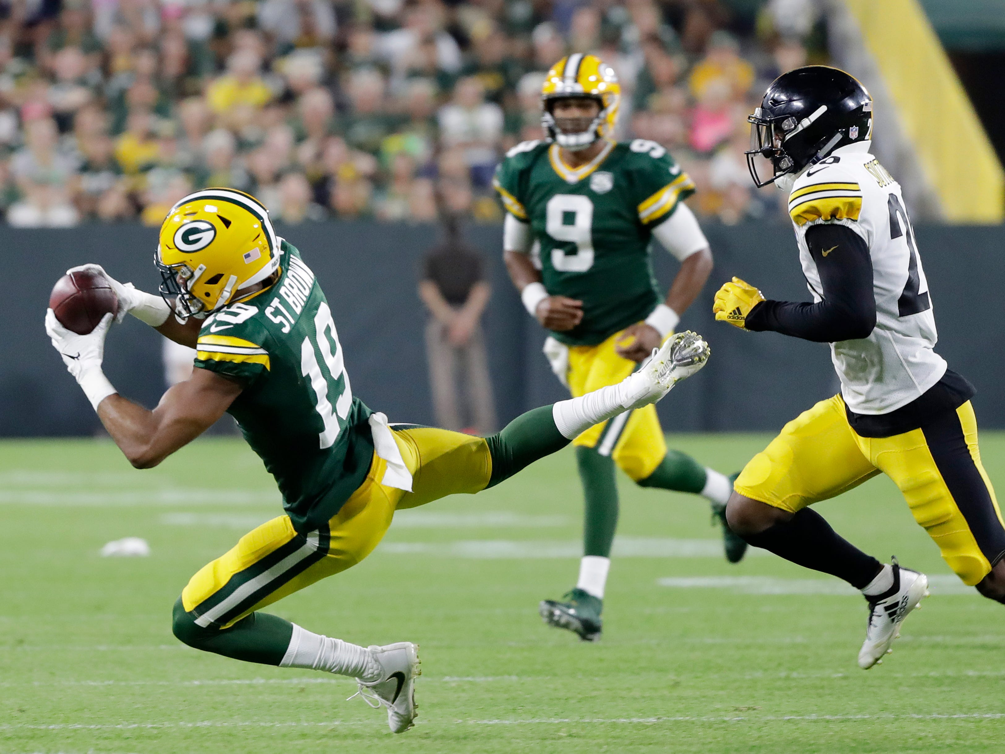 Green Bay Packers wide receiver Equanimeous St. Brown (19) catches a pass against the Pittsburgh Steelers in the second quarter of an NFL preseason game at Lambeau Field on Thursday, August 16, 2018 in Green Bay, Wis.