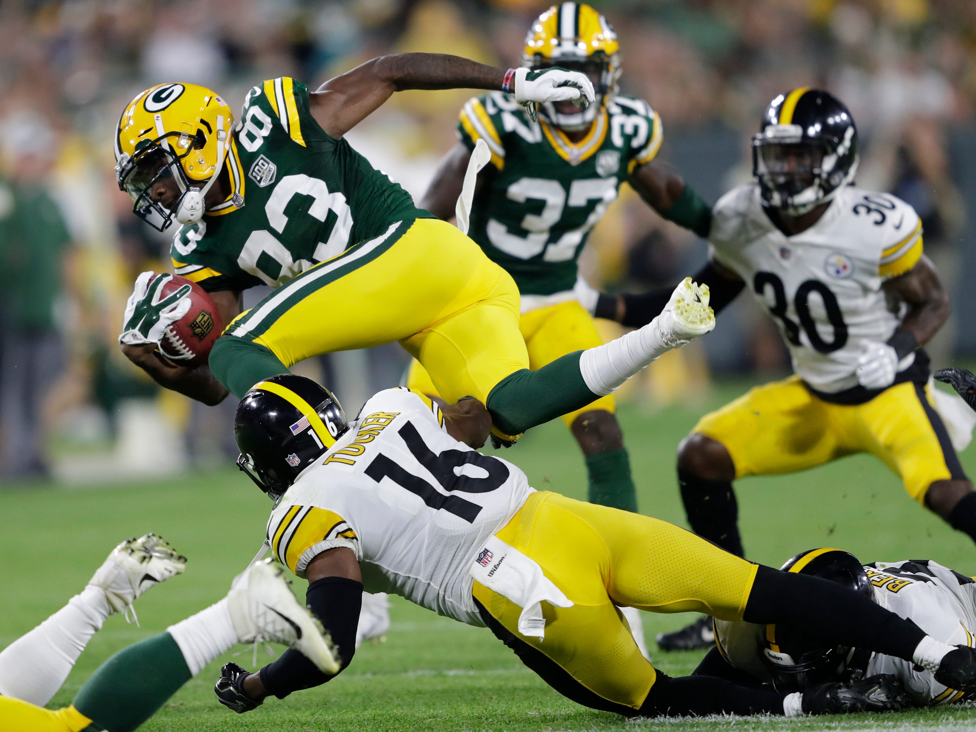 Green Bay Packers wide receiver Marquez Valdes-Scantling (83) runs back a kick off return against the Pittsburgh Steelers during their football game Thursday, August 16, 2018, at Lambeau Field in Green Bay, Wis.