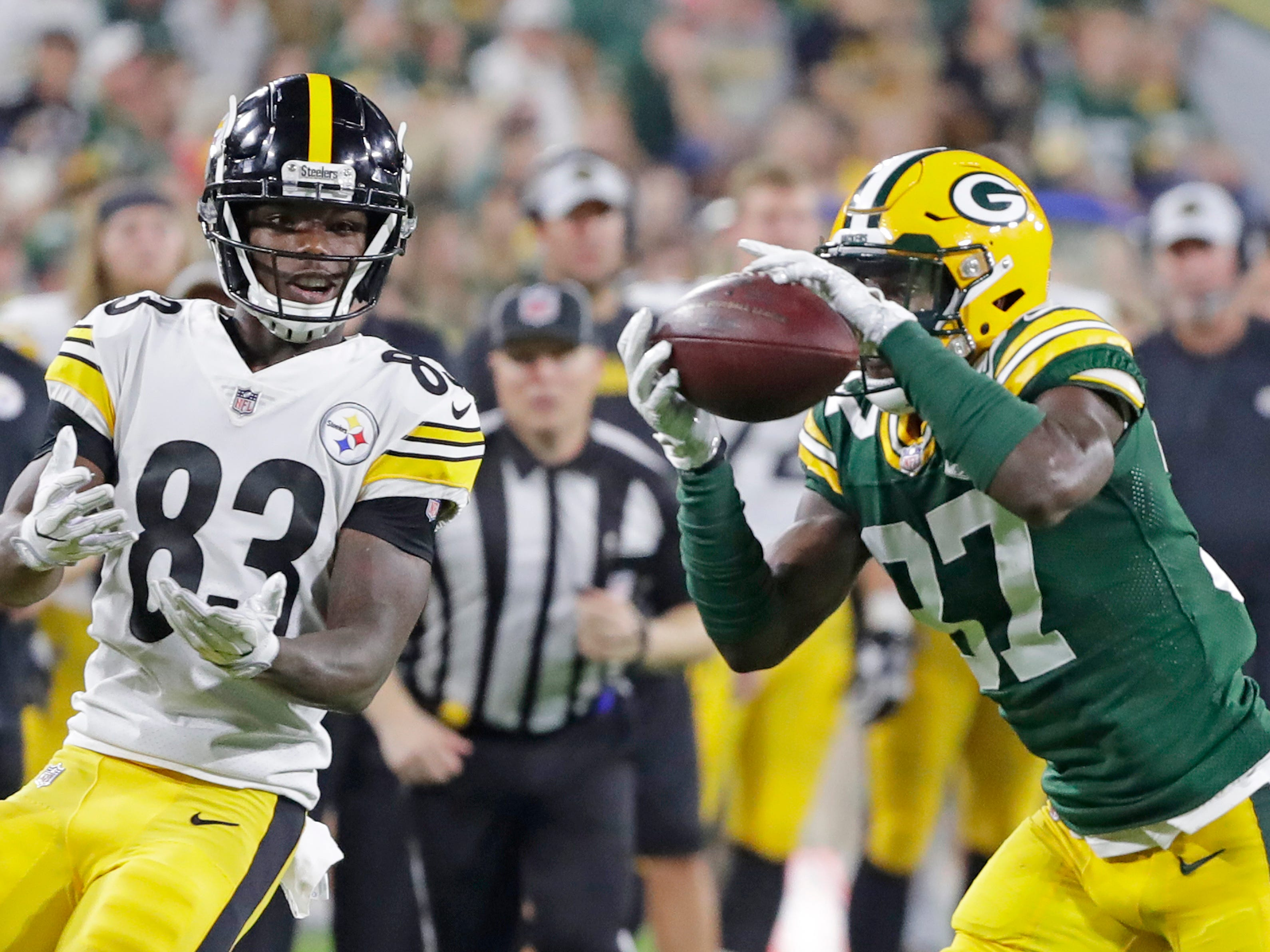 Green Bay Packers cornerback Josh Jackson (37) intercepts a pass intended for Pittsburgh Steelers wide receiver Damoun Patterson (83) in the third quarter of an NFL preseason game at Lambeau Field on Thursday, August 16, 2018 in Green Bay, Wis.