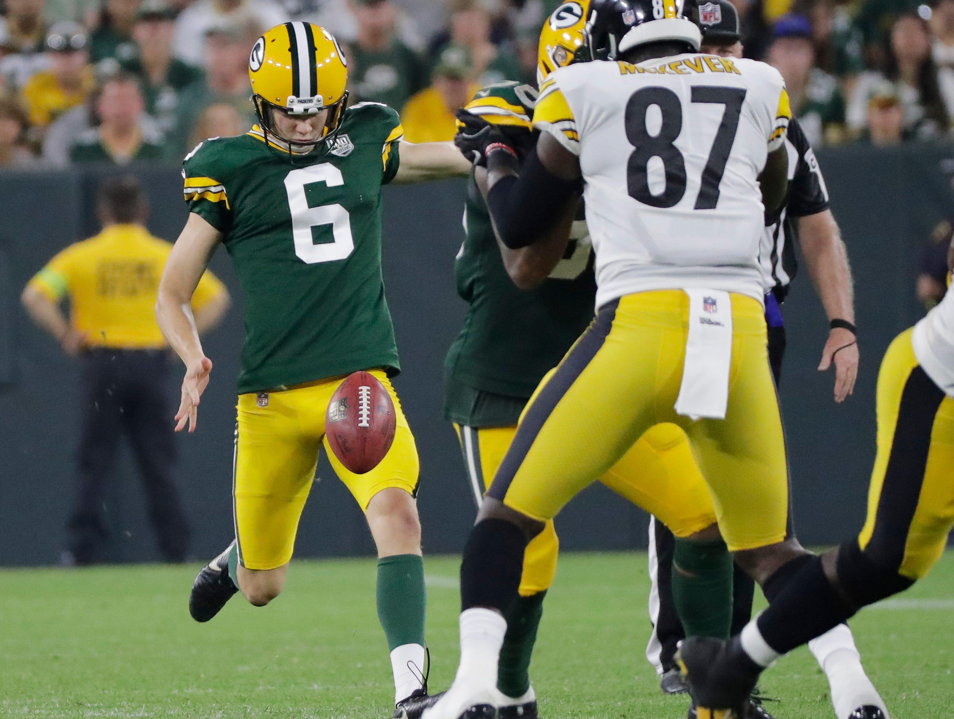 Green Bay Packers punter JK Scott (6) punts in an NFL preseason game at Lambeau Field on Thursday, August 16, 2018 in Green Bay, Wis.