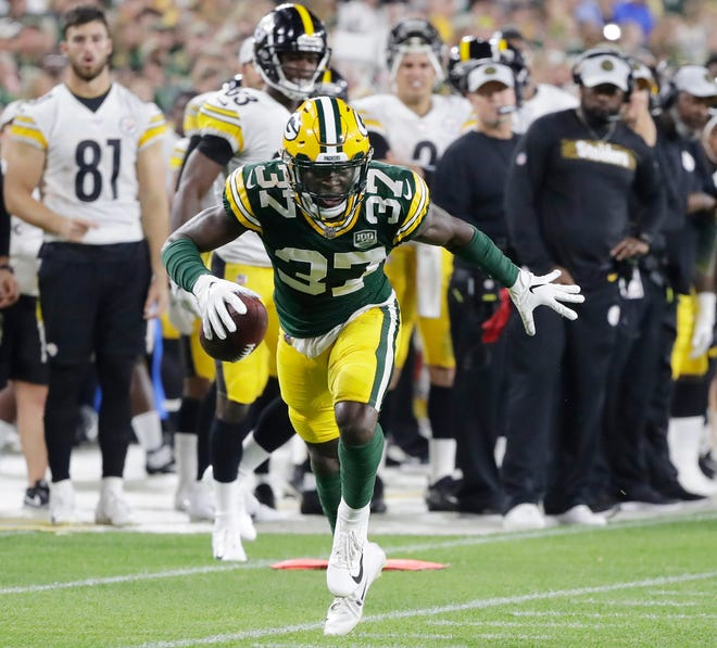 Green Bay Packers cornerback Josh Jackson (37) returns an interception for a touchdown in an NFL preseason game at Lambeau Field on Thursday, August 16, 2018 in Green Bay, Wis.