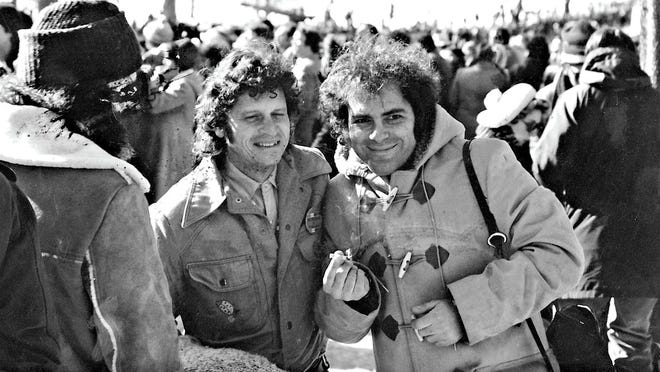 Paul Krassner (left) is seen with his Yippies co-founder Jerry Rubin, holding a marijuana cigarette, at the 1968 Chicago Democratic National Convention.