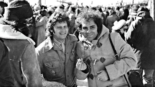 Paul Krassner (left) with Yippies co-founder Jerry Rubin, holding a marijuana cigarette at the 1968 Chicago Democratic National Convention.