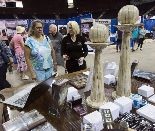 Vicki Strong consults with Molly Ann Jackson-Riley, president and founder of Defined Interiors, about home improvement ideas during the 2018 Home and Products Expo at the Pensacola Bay Center.