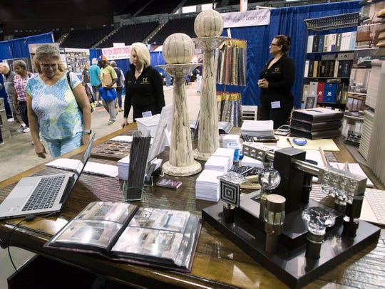 Vicki Strong stops by the booth of Defined Interiors, Inc. during her visit to the 2018 Home and Products Expo at the Pensacola Bay Center on Friday, Aug. 17, 2018.