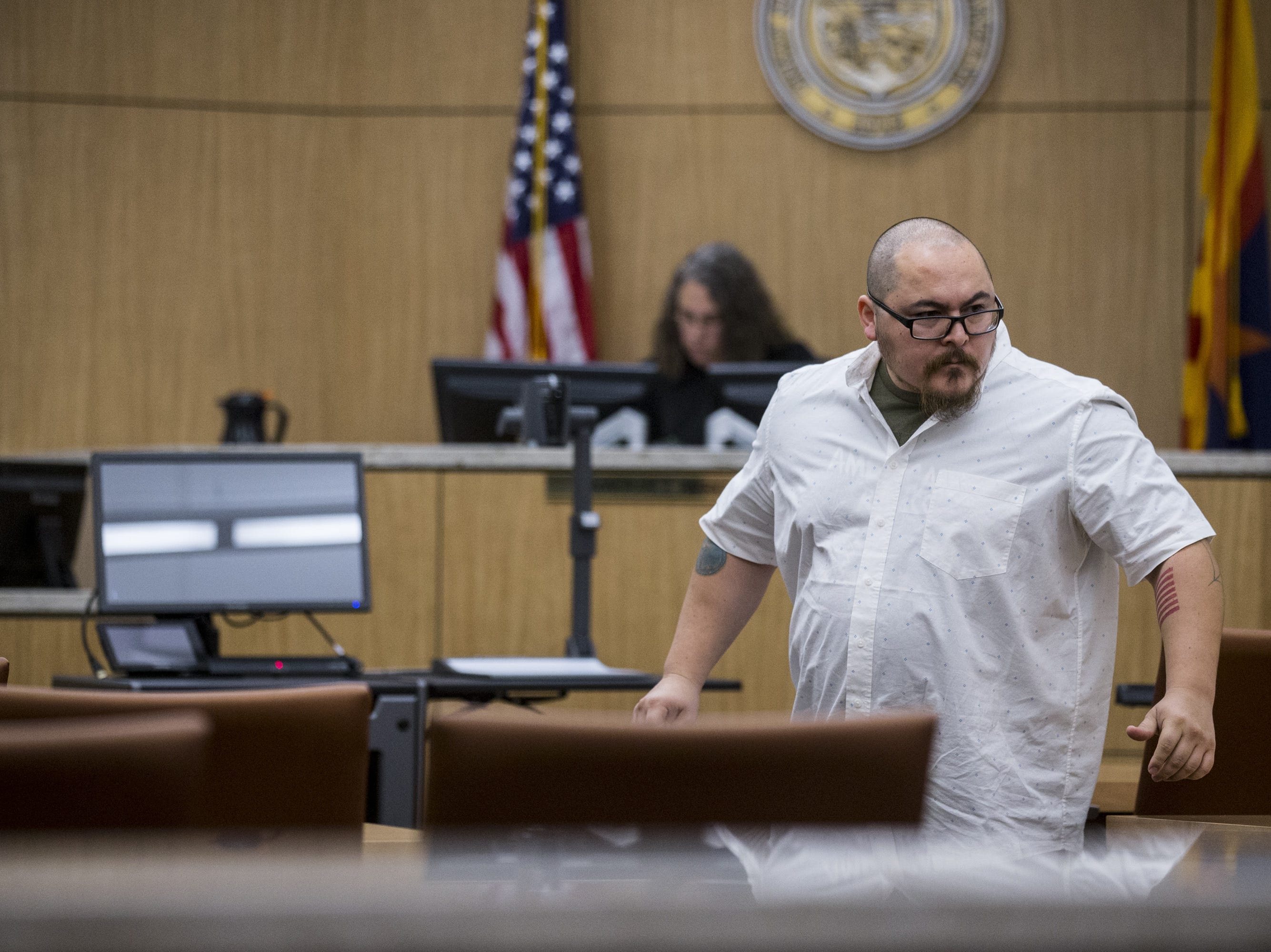 Michael Jaso leaves after receiving his judgment Friday, Aug. 17, 2018, during a hearing for people who failed to show up for jury duty at Maricopa County Superior Court in Phoenix.
