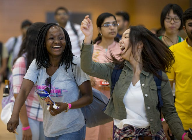 ASU international students Ermyntrude Adjei, from Ghana, and Saori Miakomi, from Japan, participate in Play Fair at the Sun Devil Fitness Center in Tempe during their orientation on Aug. 8, 2018.