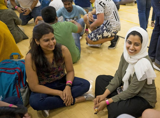 ASU international students Bhawana Prasad (left), from India, and Dania Alarfaj, from Saudi Arabia, participate in Play Fair at the Sun Devil Fitness Center in Tempe during their orientation on Aug. 8, 2018.