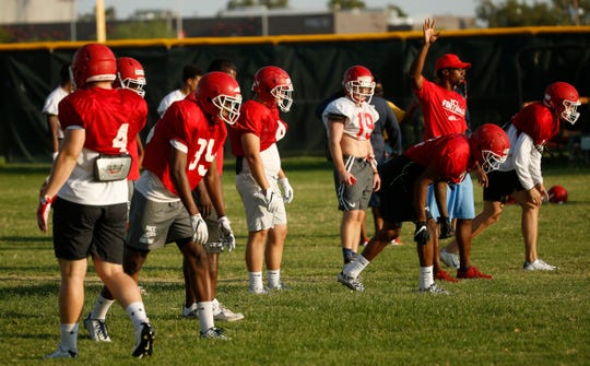 Players line up for drills during practice at Mesa Community College in Mesa, Ariz. on Aug. 16, 2018.