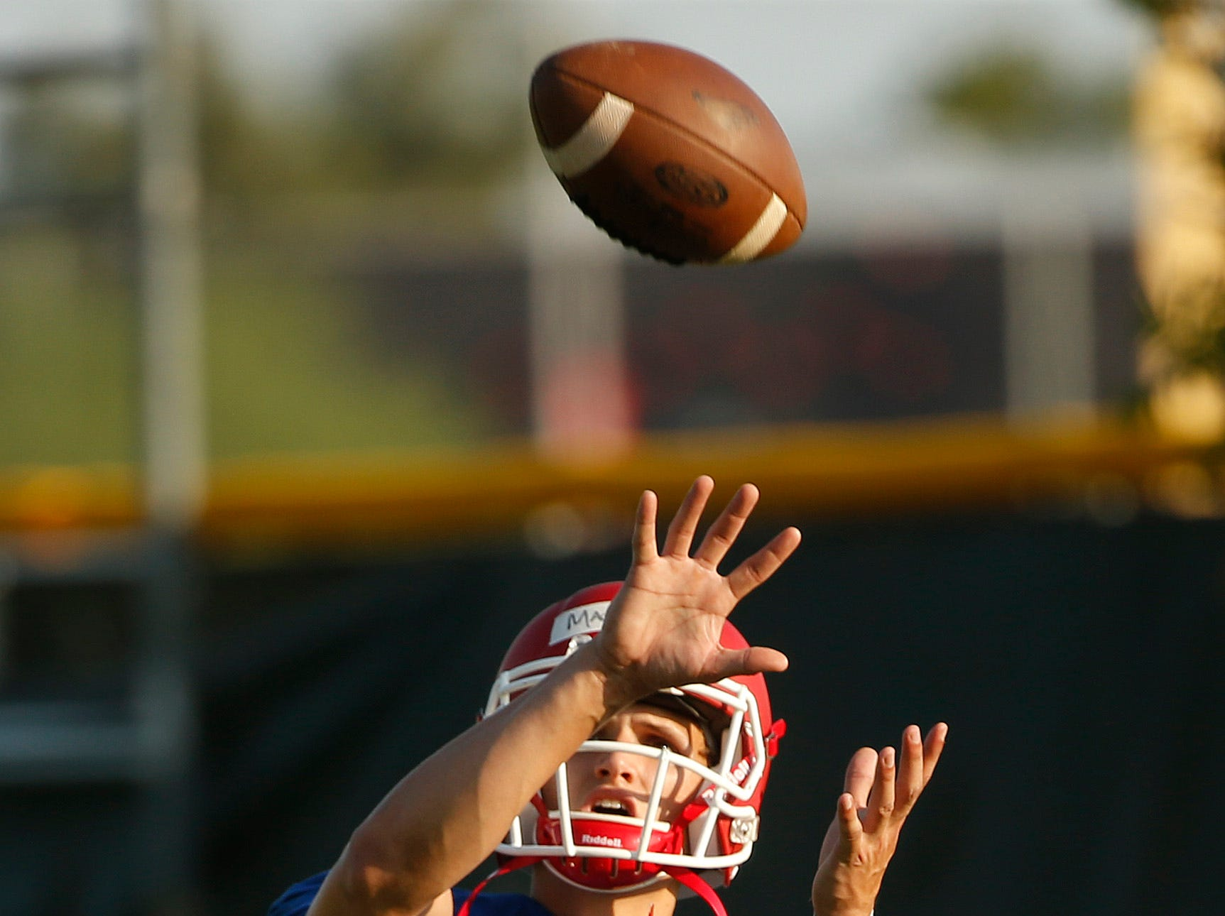 Player Thomas MacVittie catches a throw back to him during practice at Mesa Community College in Mesa, Ariz. on Aug. 16, 2018.