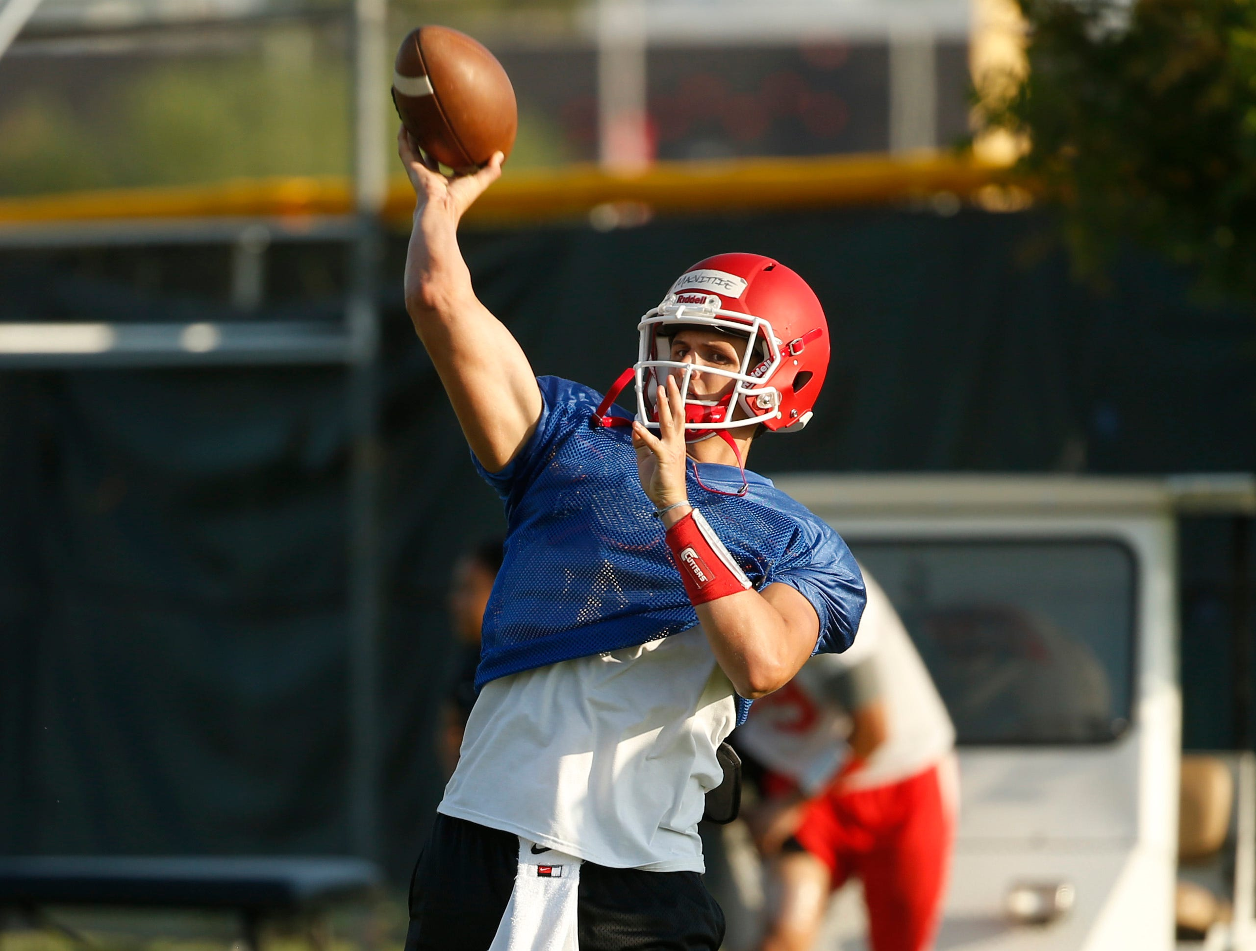 Player Thomas MacVittie throws a pass during practice at Mesa Community College in Mesa, Ariz. on Aug. 16, 2018.