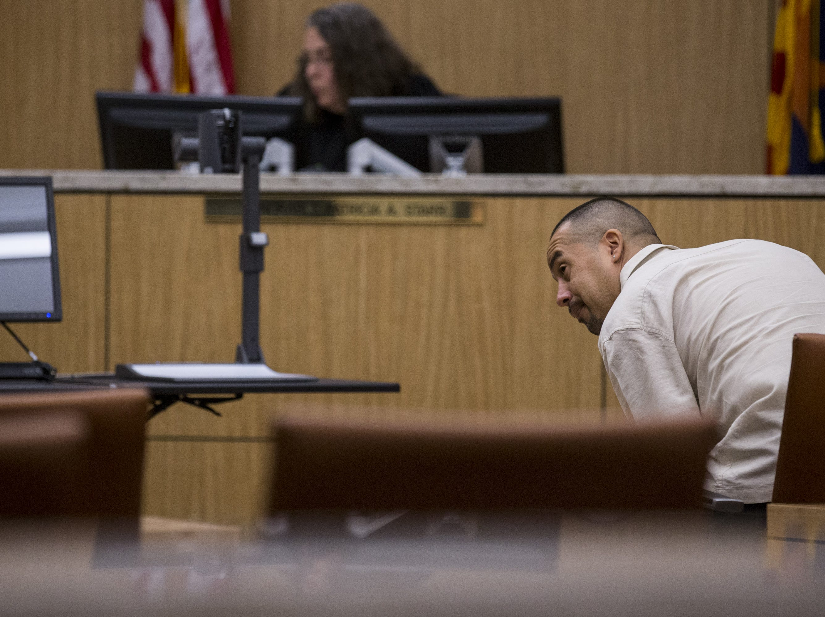 Ysidro Bracamonte leaves after receiving his judgment Friday, Aug. 17, 2018, during a hearing for people who failed to show up for jury duty on at Maricopa County Superior Court in Phoenix.