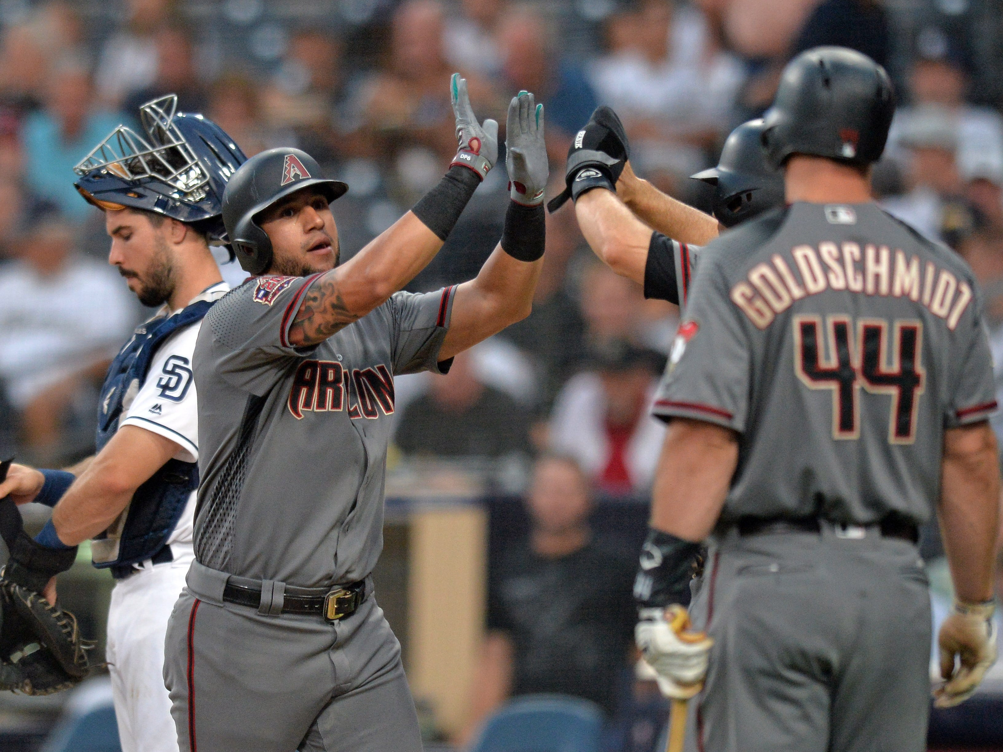 Aug 16, 2018; San Diego, CA, USA; Arizona Diamondbacks left fielder David Peralta (center) is congratulated after hitting a three run home run during the first inning against the San Diego Padres at Petco Park.
