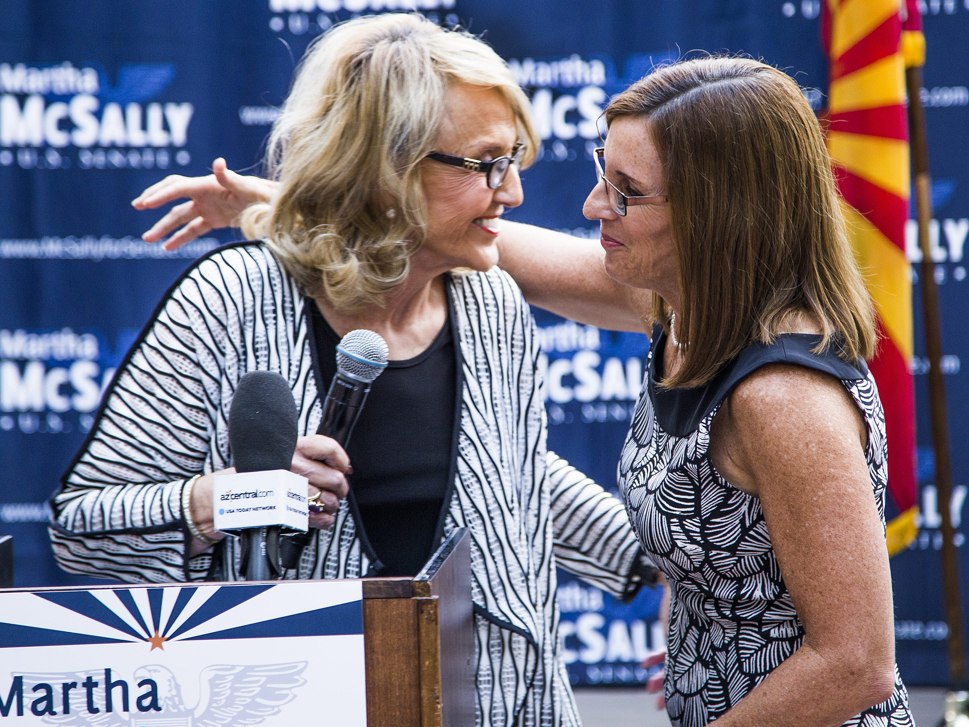 U.S. Rep. Martha McSally (right) gets a hug from former Arizona Gov. Jan Brewer as McSally is introduced at an event in Phoenix announcing a coalition of women on Aug. 15, 2018.