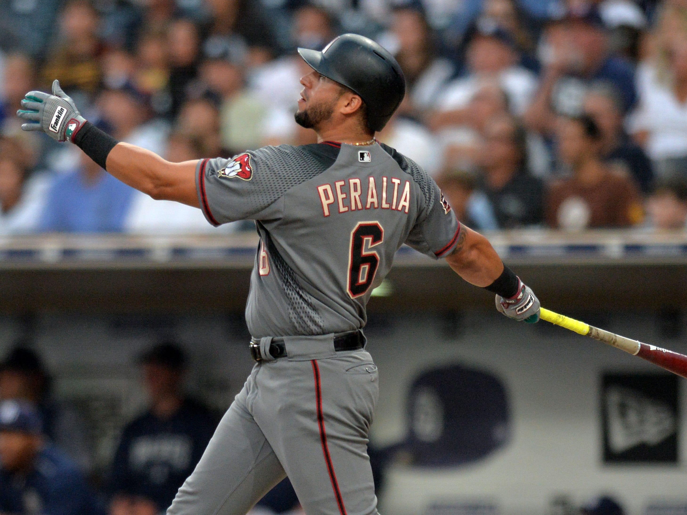 Aug 16, 2018; San Diego, CA, USA; Arizona Diamondbacks left fielder David Peralta (6) hits a three run home run during the first inning against the San Diego Padres at Petco Park.