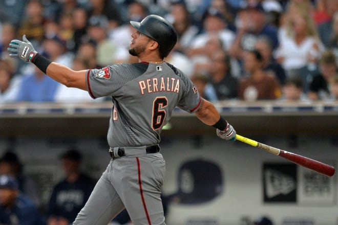 Aug 16, 2018; San Diego, CA, USA; Arizona Diamondbacks left fielder David Peralta (6) hits a three run home run during the first inning against the San Diego Padres at Petco Park.