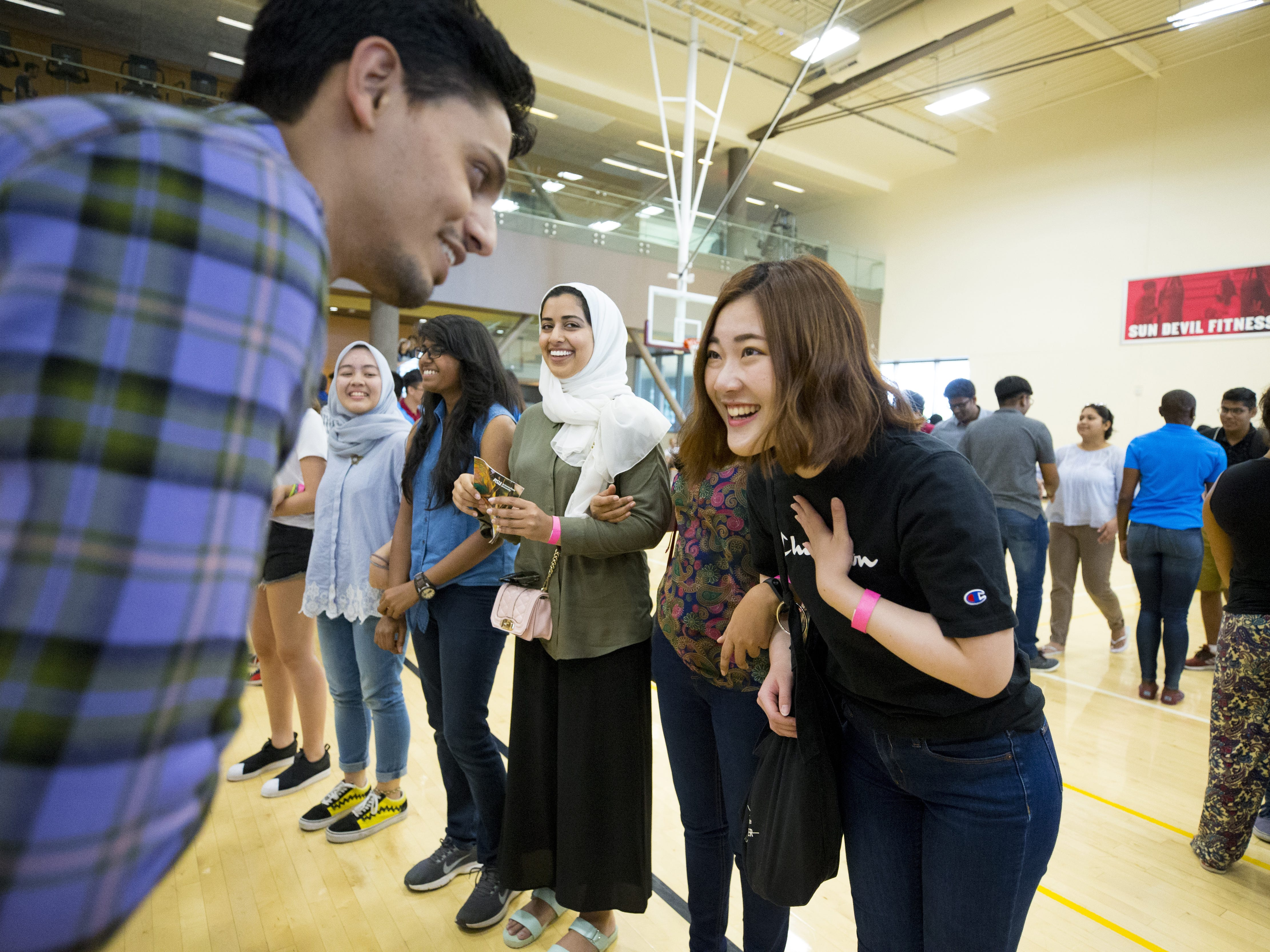 ASU international students Rohan Shasbi, from India, introduces himself to Natsuki Kanno, from Japan, during Play Fair at the Sun Devil Fitness Center in Tempe on Aug. 8, 2018.