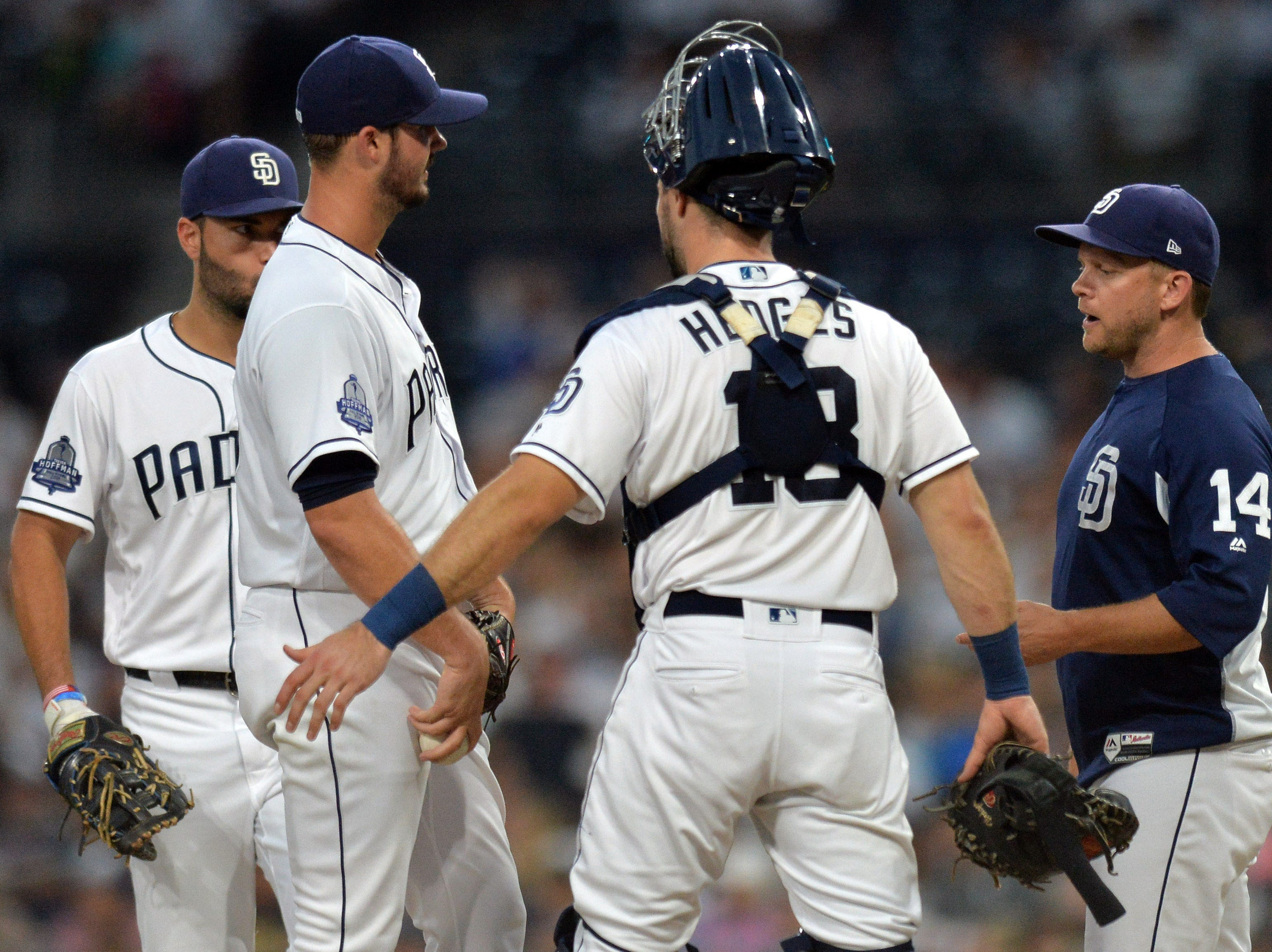Aug 16, 2018; San Diego, CA, USA; San Diego Padres manager Andy Green (14) takes San Diego Padres starting pitcher Jacob Nix (one from left) out of the game after giving up five runs in the first inning against the Arizona Diamondbacks at Petco Park. Mandatory Credit: Jake Roth-USA TODAY Sports