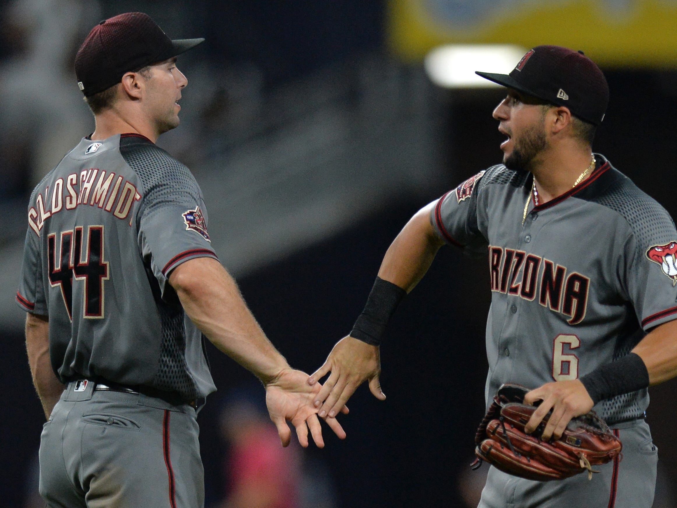 Aug 16, 2018; San Diego, CA, USA; Arizona Diamondbacks first baseman Paul Goldschmidt (44) and left fielder David Peralta (6) celebrate a 5-1 win over the San Diego Padres at Petco Park.