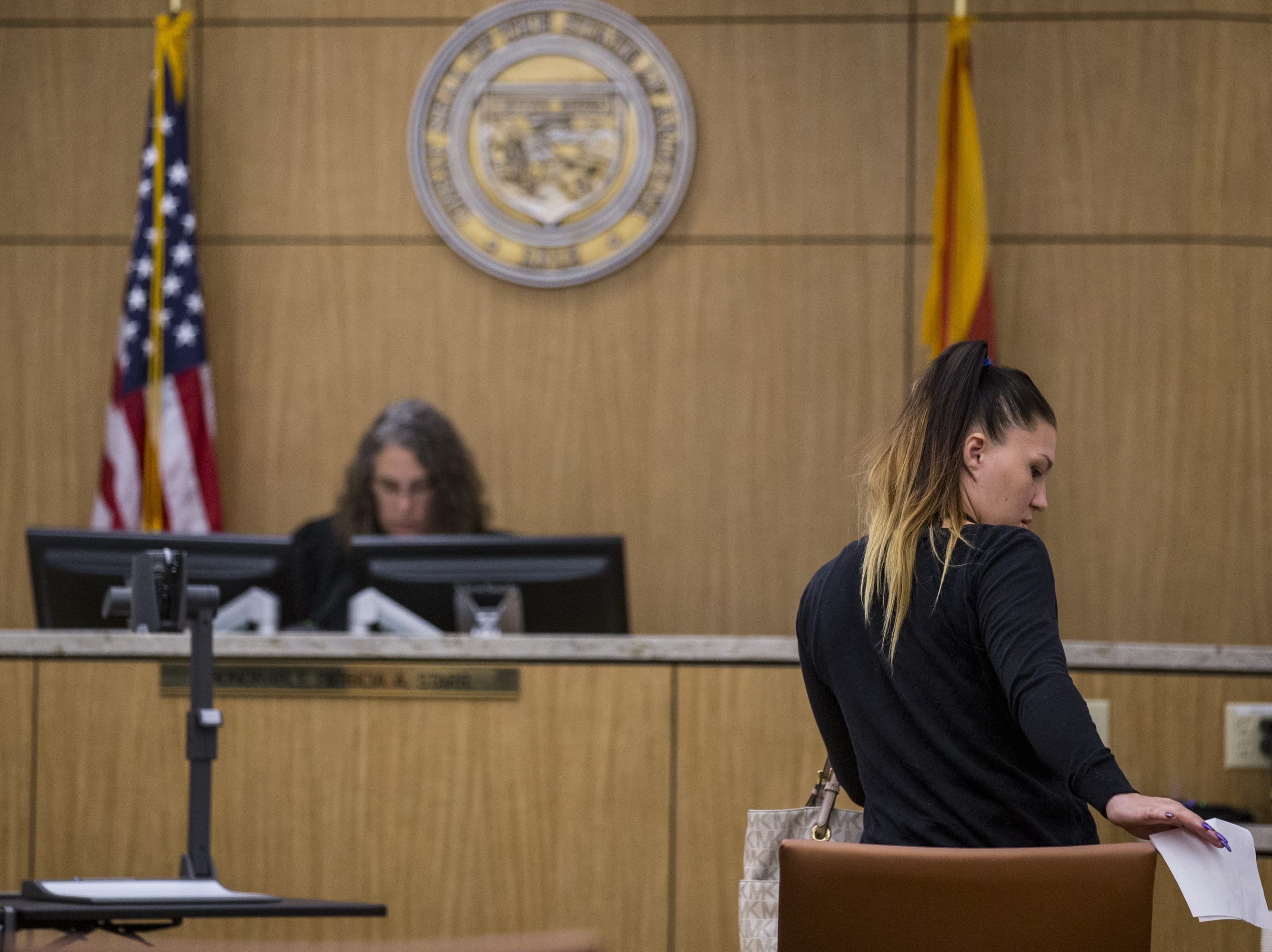 Jessica Tyrek leaves after receiving her judgment Friday, Aug. 17, 2018,  during a hearing for people who failed to show up for jury duty at Maricopa County Superior Court in Phoenix.