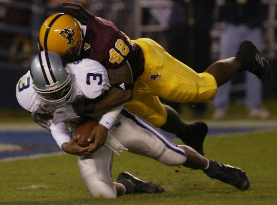 12/27/2002-- ASU's Terrell Suggs sacks Kansas State QB Ell Roberson #3 during first half action at the Holiday Bowl in San Diego, CA.  Republic photo by Rob Schumacher