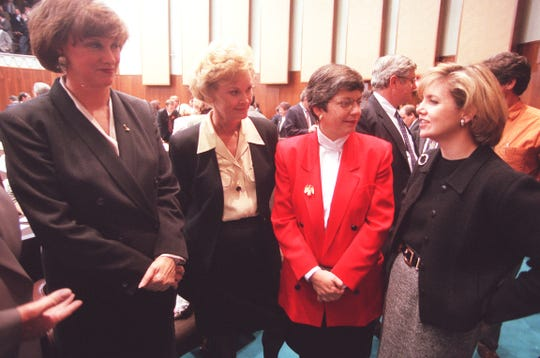 Secretary of State Betsey Bayless, state treasurer Carol Springer,  attorney general Janet Napolitano and Superintendent of Education Lisa Graham-Keegan meet on the house floor before to Governor Jane Dee Hull's address in January 1999.