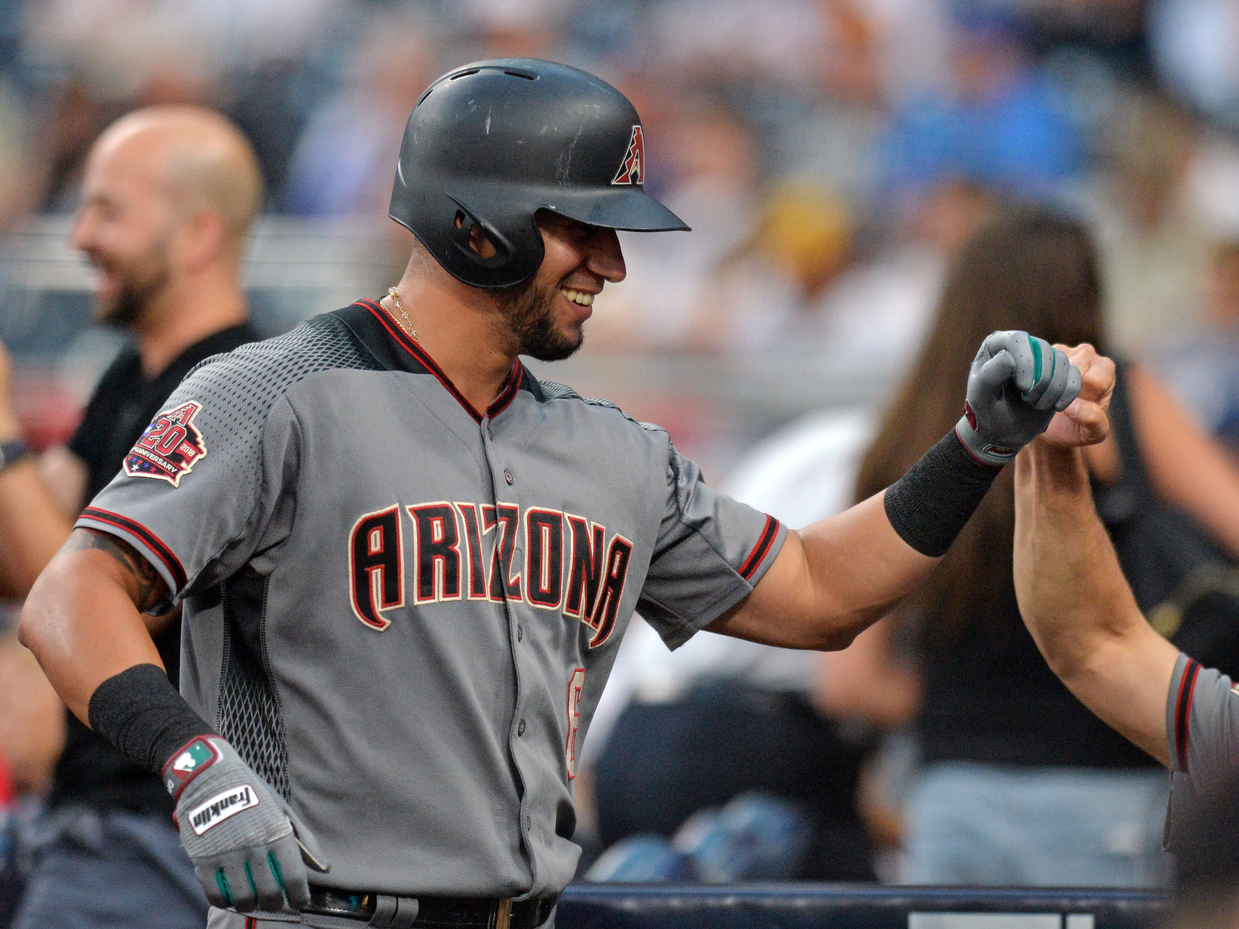 Aug 16, 2018; San Diego, CA, USA; Arizona Diamondbacks left fielder David Peralta (left) is congratulated by manager Torey Lovullo (far right) after hitting a three run home run during the first inning against the San Diego Padres at Petco Park.
