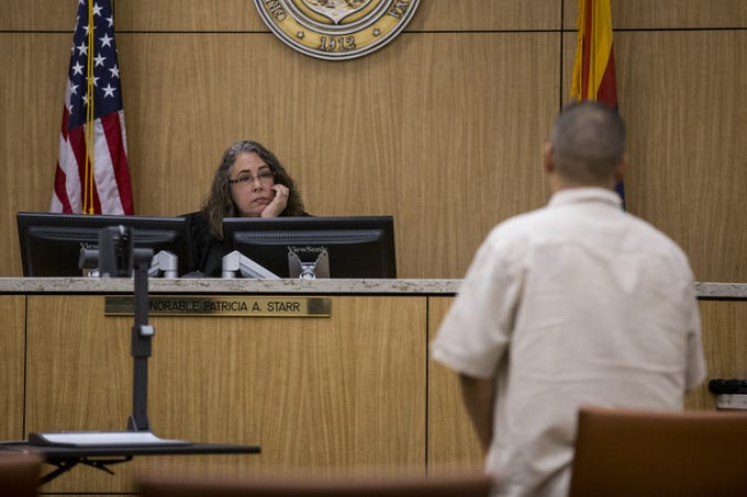 Judge Patricia Starr listens to Ysidro Bracamonte on Friday, Aug. 17, 2018, during a hearing for people who failed to show up for jury duty at Maricopa County Superior Court in Phoenix.
