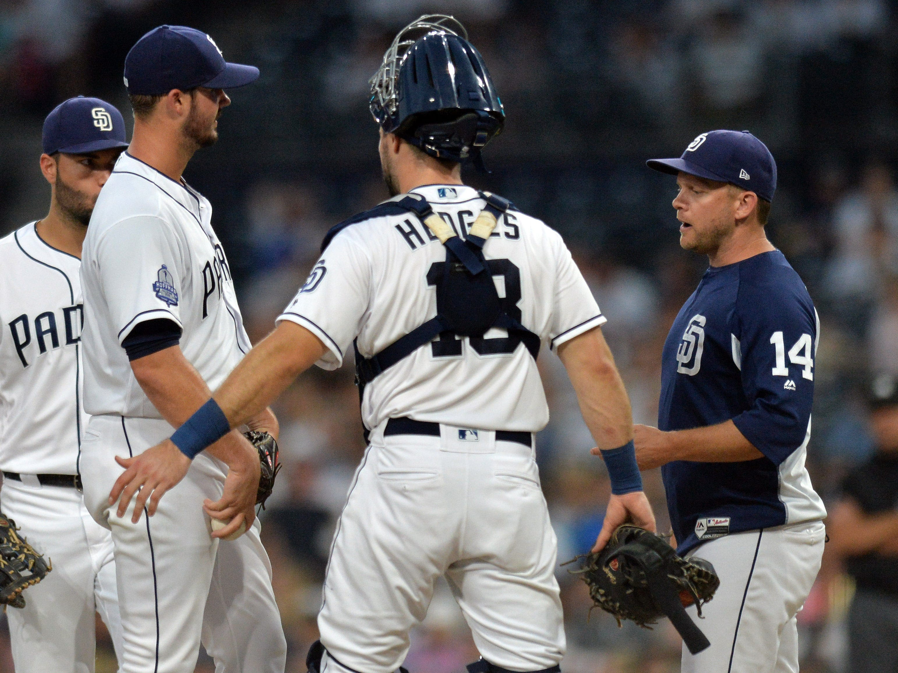 Aug 16, 2018; San Diego, CA, USA; San Diego Padres manager Andy Green (14) takes San Diego Padres starting pitcher Jacob Nix (one from left) out of the game after giving up five runs in the first inning against the Arizona Diamondbacks at Petco Park.