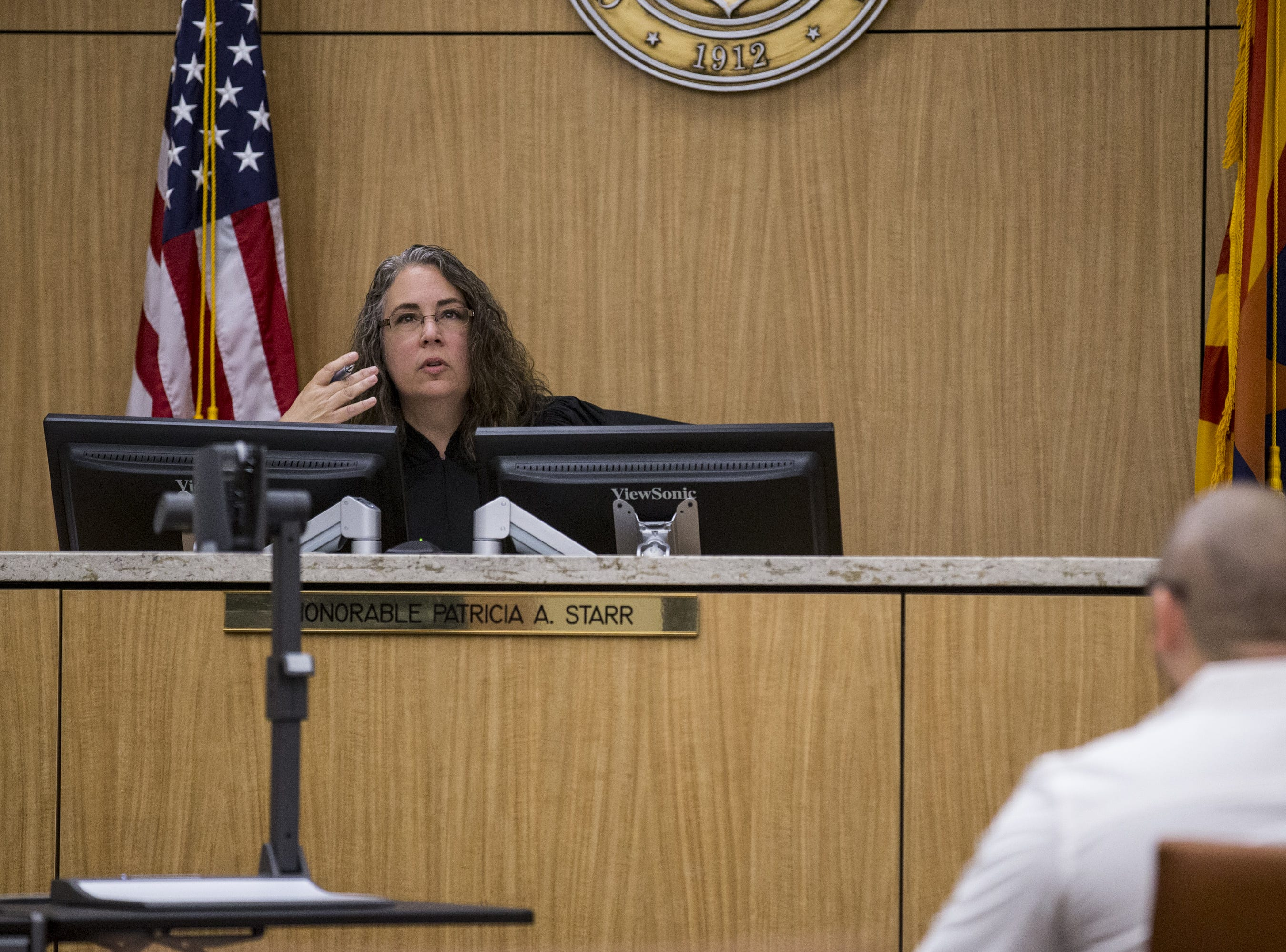 Judge Patricia Starr speaks to Michael Jaso on Friday, Aug. 17, 2018, during a hearing for people who failed to show up for jury duty at Maricopa County Superior Court in Phoenix.