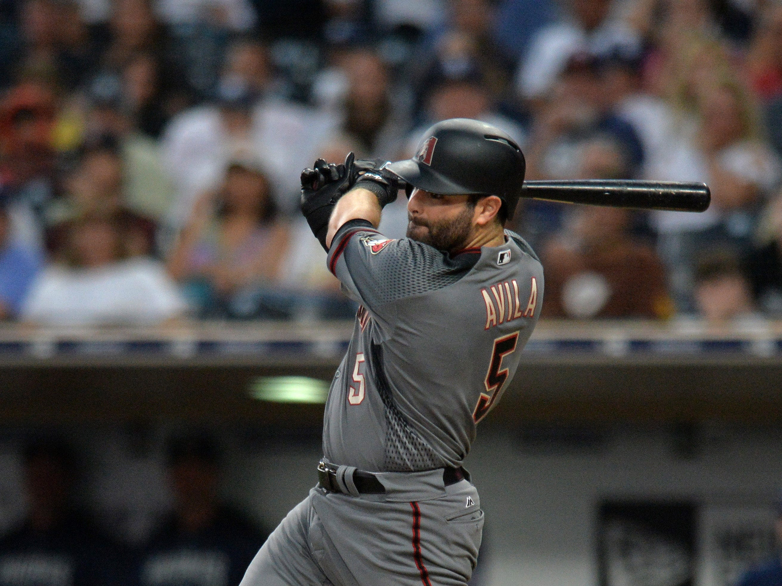 Aug 16, 2018; San Diego, CA, USA; Arizona Diamondbacks catcher Alex Avila (5) hits a two RBI single in the first inning against the San Diego Padres at Petco Park. Mandatory Credit: Jake Roth-USA TODAY Sports
