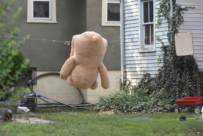 A large teddy bear lays across a clothes line to dry out in the yard of a home on N. Tulpehocken Street in Pine Grove, Pa., on Wednesday, Aug. 15, 2018. Heavy rains caused flooding across Schuylkill County on Monday. (Jacqueline Dormer/Republican-Herald via AP)