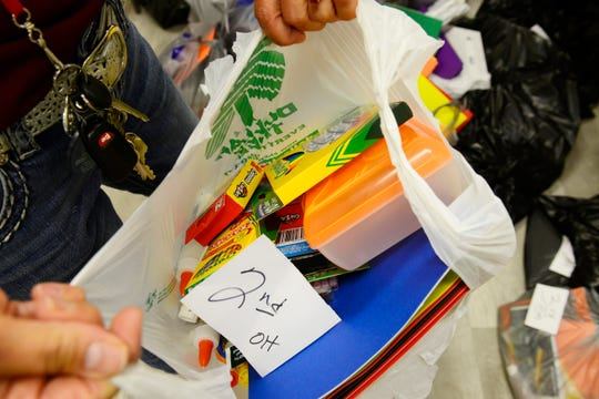The Salvation Army in Port Clinton distributed backpacks, notebooks, pencils and other school supplies on Friday.