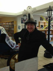 Mark Moellman gets into the spirit of a previous Elmore Ghost Walk.