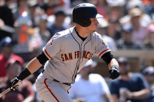 San Francisco Giants second baseman Joe Panik bats against the San Diego Padres in July.