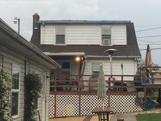 A view from the back of the house on Copenhaffer Road in Conewago Township where the metal roof flew off during a storm on Friday, Aug. 17, 2018. The family was home at the night, though no injuries or other damage was reported.