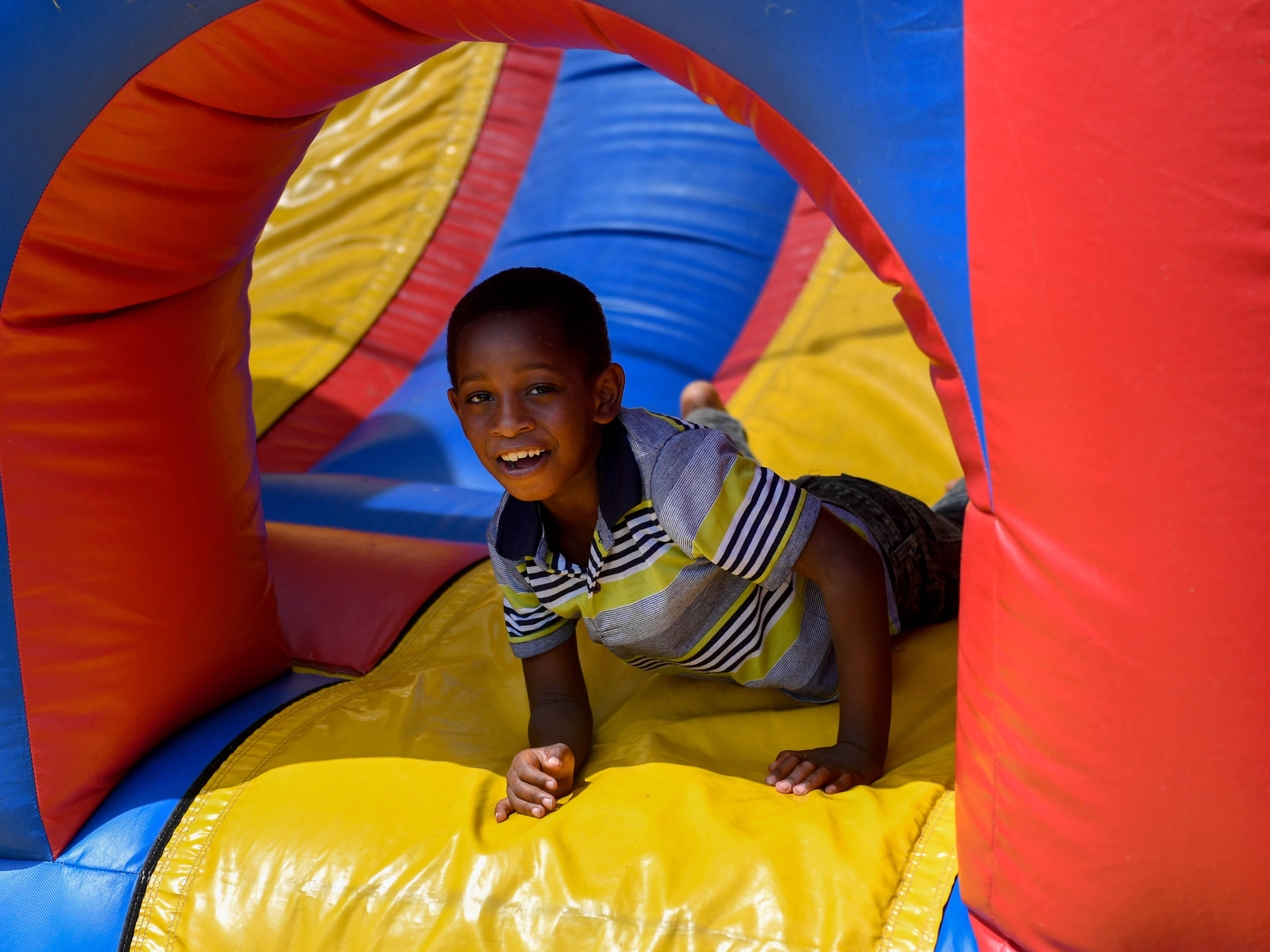 Maseyer Hope finishes the inflatable obstacle course during the City of York's United Back to School Resource Fair, Wednesday, Aug. 17, 2018.