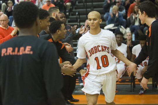 Northeastern's Marcus Josey is introduced with the starting lineup prior to a high school basketball game on Dec. 4, 2015 in the Bobcat Tip-Off Classic at Northeastern High School.