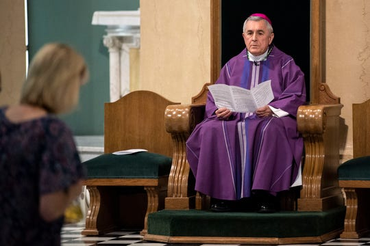 Bishop Ronald Gainer sits during the start of the 'Mass of Forgiveness' at Saint Patrick Cathedral in Harrisburg on Friday, August 17, 2018. The mass was part the Church's 'on-going need for repentance and healing,' according to the Diocese of Harrisburg's website.