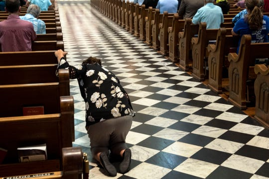 A women prays before leaving the church following the 'Mass of Forgiveness' at Saint Patrick Cathedral in Harrisburg on Friday, August 17, 2018. The mass was part the Church's 'on-going need for repentance and healing,' according to the Diocese of Harrisburg's website.