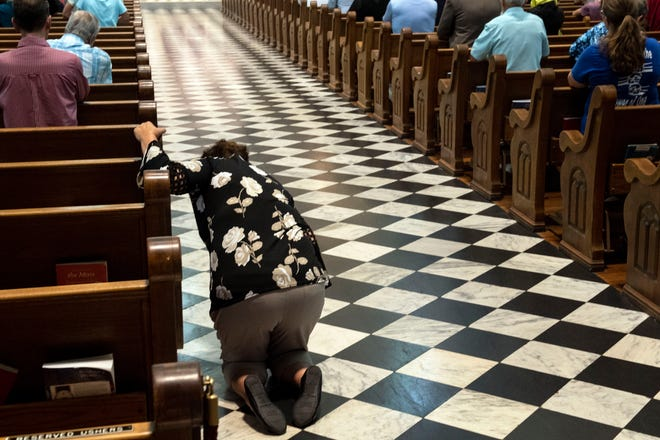 A women prays before leaving the church following the Mass of Forgiveness at Saint Patrick Cathedral in Harrisburg on Friday. The Mass was part of the church's 'on-going need for repentance and healing,' according to the Diocese of Harrisburg's website.