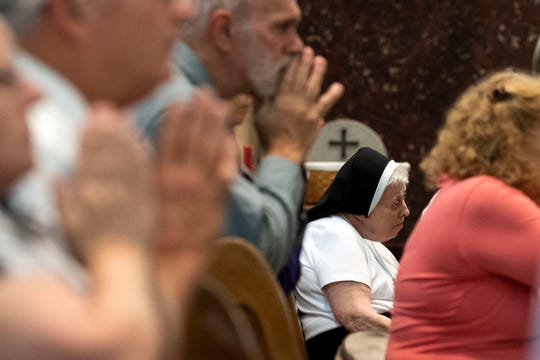 Parishioners pray during a 'Mass of Forgiveness' at Saint Patrick Cathedral in Harrisburg, Pa., on Aug. 17. The mass was part the church's 'on-going need for repentance and healing,' according to the Diocese of Harrisburg's website.