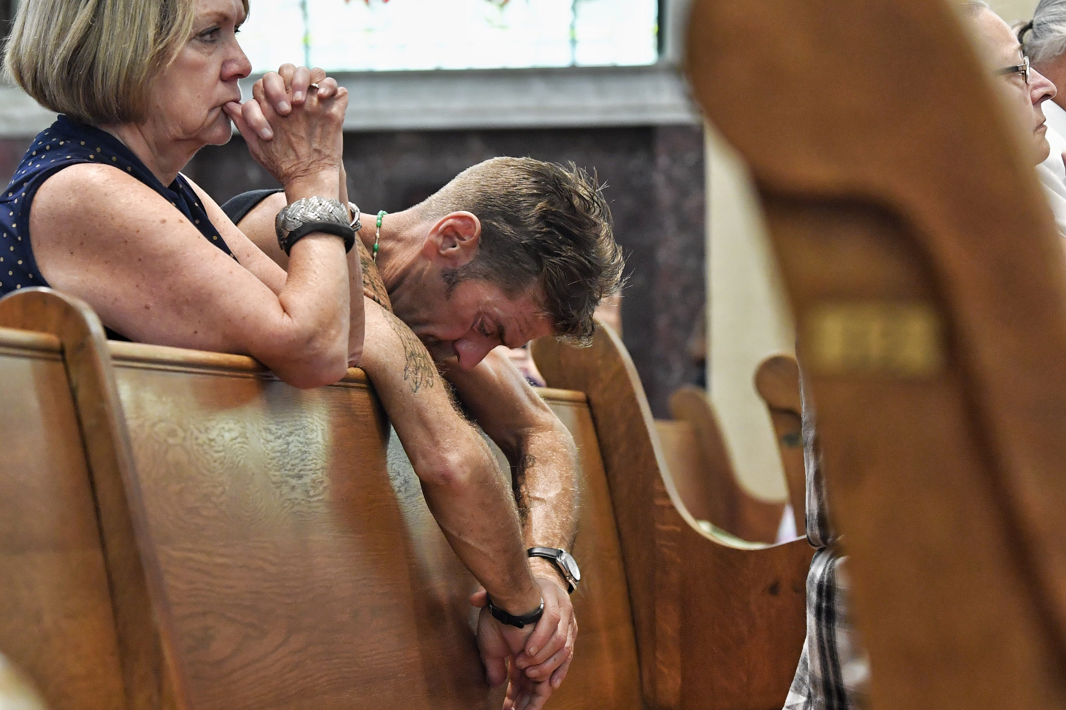 """A parishioner prays during communion at the """"Mass of Forgiveness"""" at the Cathedral Parish of Saint Patrick in Harrisburg, Pennsylvania, in August 2018."""